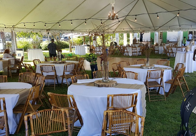 Bamboo Chairs under a White Tent